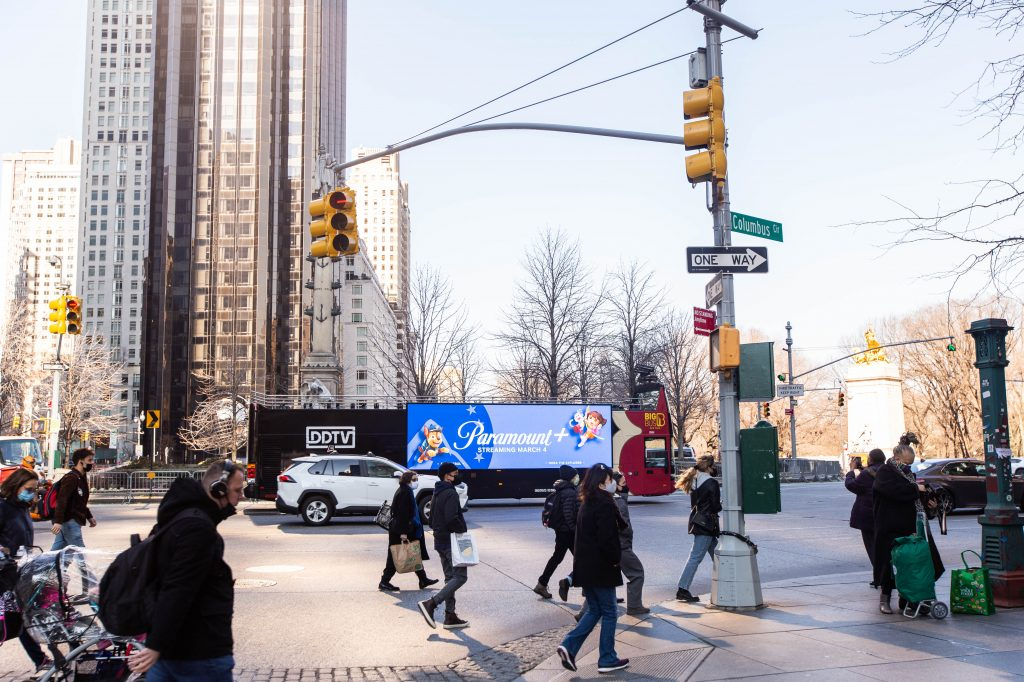 DDTV for Paramount Plus digital out of home ad on the side of a double decker bus in new york city