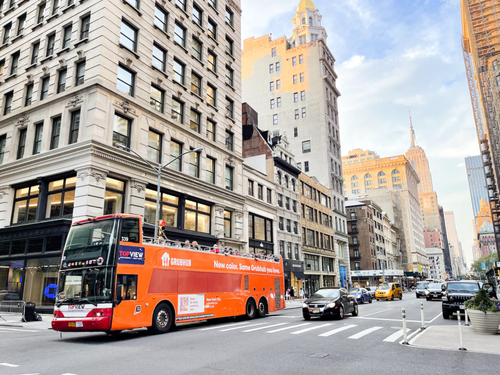 Grubhub double decker bus ad on 5th ave in new york city